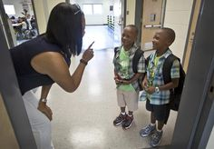 Third grade teacher Tina Hankins Chelgren tries to identify twins Ty'quan and Arreon Cherry during the first day of school on Tuesday at Kiln Creek Elementary in Newport News. (Photo by Joe Fudge / Daily Press)