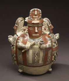 """Effigy Bottle - Northern Peru's pottery traditions focus on three-dimensionality, the vessels often modeled into a variety of forms depicting human figures, fruits or vegetables and even architecture. The Walters Art Museum in the special exhibition """"Exploring Art of the Ancient Americas: The John Bourne Collection Gift."""" http://art.thewalters.org/detail/80192/effigy-bottle/"""