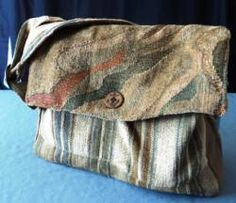 """Small Scale Messenger Bag: Made from up-cycled upholstery samples and lined with satin lining fabric. Decorative large button closure. Bag measures 3""""W X 9 1/2""""H X 13""""L . $45.00   holsomheartdesigns.com"""