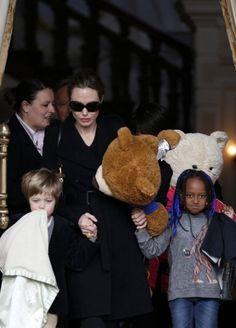 "Angelina Jolie, Shiloh & Zahara Leave Their Amsterdam Hotel ""Bearing"" Gifts!"