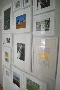 photo gallery wall; white IKEA Ribba frames I want this in the guest room above the desk. I like her blog, similar decor styles.