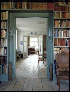 Bookshelves over door frame.