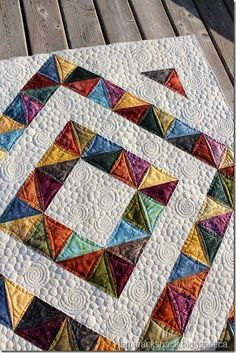 HST quilt with tutorial from charms - the layout and FMQ are stunning.