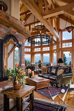 roger wade studio interior design photography of living room in rustic western timber frame home towards window view of the san juan mountains, ridgway, colorado, by bensonwood