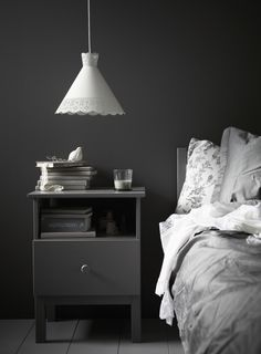 Black wall, white and grey textiles bedroom.