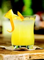 Pineapple Cinderella Mocktail  1 ounce Torani Pineapple Syrup  1 ounce orange juice  3 ounces ginger ale  Dash of lemon juice  1 cup of ice