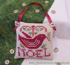 Heart in Stitches: Pillow ornament with button and ribbon hang tie.