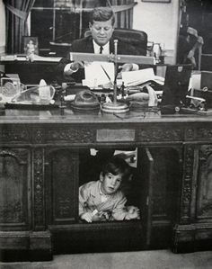 President John Kennedy (1917-1963) and son John, Jr. (1960-1999) in the Oval Office.