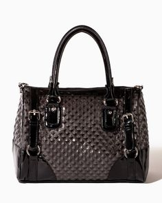 Live the diamond life in a patent faux leather satchel with textured diamond quilting and contrast trim. Features two rolled handles and a detachable crossbody strap. Top zip closure and adjustable buckles with polished metal rings at the sides.