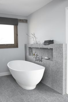 Juno Honed Granite. Graphite, silver and grey shades characterise this robust,durable and cost effective granite. http://www.mandarinstone.com/product/_/547/juno-honed/ #mandarinstone #granite #inspiration #bathroom #featurewall #stone