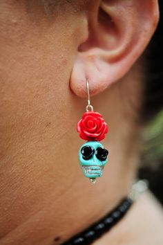 Teal and red skull earrings