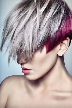 fuschia low-lights, very short in back, longer in front.. very interesting cut; i can think of several different ways to style it :)