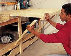 flip-up assembly bench - this'll definitely come in handy in the new shed. workbenches, garage workshop, modular workbench, flipup tabl, cleats, organ, new homes, potting tables, work bench