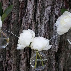 Make this beautiful garland out of bud vases and your favorite summer flowers by Swoon.