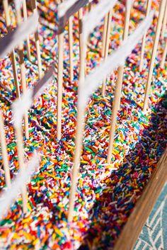 escort cards embedded in rainbow sprinkles.
