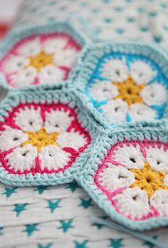 Pastel African flower crochet. Pattern here http://heidibearscreative.blogspot.ie/2010/05/african-flower-hexagon-crochet-tutorial.html