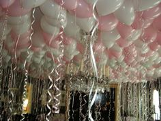 Sandra @ ribbonsandfavors.com  Helium filled balloons and curling ribbon. A great way to lower or hide an ceiling it at your wedding or party venue.
