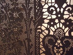 Lost in Lace exhibition:Piper Shepard hand cut lace.  -Use of lace against light