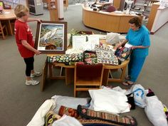 ATHA Gator Group artists get their hooked work ready for display at the Library.
