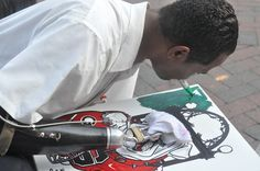 artist in Athens, GA....does UGA-themed artwork holding Sharpies in his mouth because he has no hands. inspiring story.