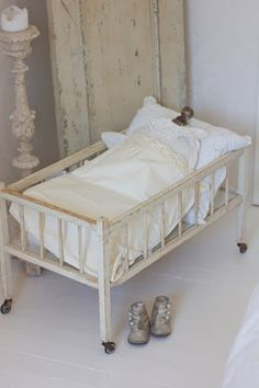 Vintage doll bed and baby shoes...