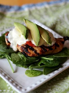 Grilled chicken breast with tomato, mozzarella, and avocado over baby spinach - low carb