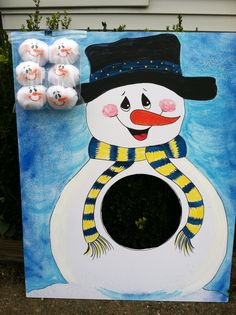 Snowball Toss Game. Snowman made from foam core board. Snowballs made with fleece and painted faces.