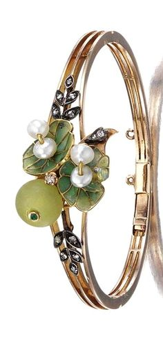 GOLD, GEM-SET AND DIAMOND BANGLE, LATE 19TH CENTURY The hinged bangle applied to the centre with a foliate motif, embellished with pearls, rose-cut diamonds and plique-a-jour enamel leaves, length approximately 165mm, French import marks.