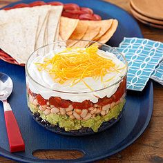 Our take on the classic Six-Layer #Mexican Dip includes two kinds of iron-rich beans, heart-healthy avocados, and vegetable-filled salsa.