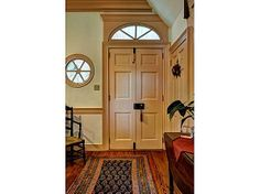 Colonial foyer on pinterest 28 pins for Mckie wing roth home designs