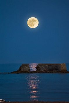 full moon over the ocean...