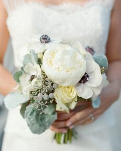 White Wedding by marthastewart: Bride's bouquet out of anemones, seeded eucalyptus, silver brunia, roses, and dusty miller by Sidra Forman. #Wedding #Flowers
