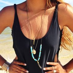 beach necklaces + tank.