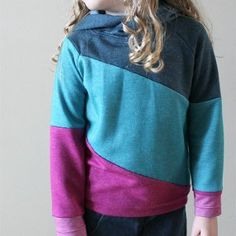 Make your little girl an amazingly stylish and comfy sweater when you create the Cozy Color Block Sweater. This DIY color block tutorial is a great way to add some color to your kid's wardrobe without losing the function.