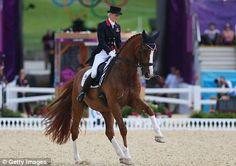 Laura Bechtolsheimer riding Mistral Hojris in the individual dressage
