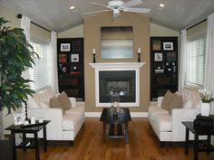 Love that darker beige around the fireplace!
