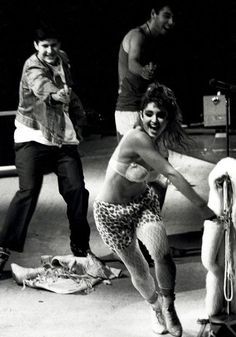 The Beastie Boys chasing Madonna with squirt guns.