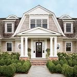 Architectural Digest - Alexa Hampton - Gorgeous home exterior with boxwoods.
