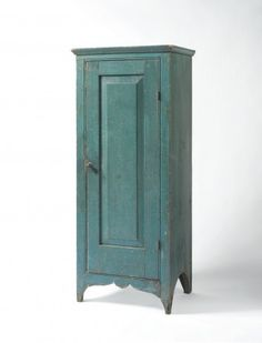 19th c. Pennsylvania pine small standing cupboard with single raised-panel door in original blue paint, c.1820-40 Sold: $15,340 ($13,000)