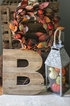 Loving that big reclaimed wood B and the galvanized lantern!  That's some easy fall decor right there!