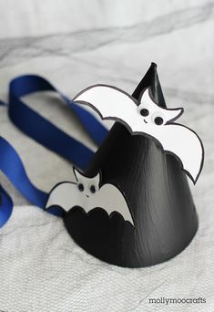 DIY Batty Witch Party Hats - so much fun to wear for any Halloween party or if you throw your own spooky gathering, the kids could make these hats as a fun craft-activity! #halloweencrafts #witch #batcrafts #partyhats
