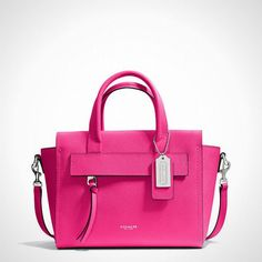 This bright pink number is the perfect carryall for spring. purs