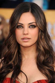 Dark brunette hair with caramel highlights.