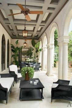 Stone terrace with coffered ceiling.