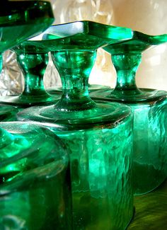 Luminous emerald green glass decanters would be perfect for a Wizard of Oz inspired bar #pantone #emerald #green #2013