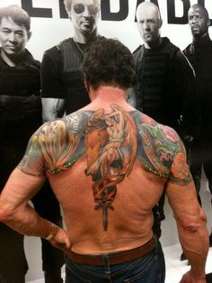 Sly Stallone back tattoo.
