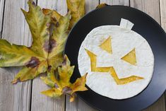 Easy Halloween dinner idea: cut a tortilla for a Jack-o-Lantern Quesadilla.