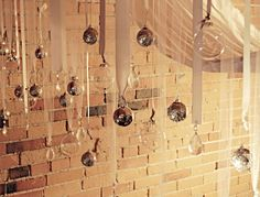 DIY Hang Christmas decorations from ribbon or tulle for pretty light catching effect...
