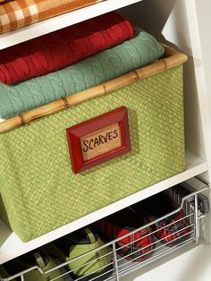 Small photo frames glued onto baskets for labeling - instead of inserting labels, insert scrapbook paper and use a dry erase or permanent marker to write on frame glass (permanent markers can be erased with rubbing alcohol if label needs to be changed).