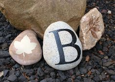 DIY Stenciled Garden Rocks with Monogram. Personalize your yard or garden with these easy to make decorative rocks using stencils and Paint.